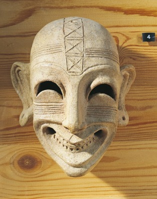A fourth-century B.C. Phoenician mask found in Tunisia displays a grin not unlike those seen on victims of an ancient Phoenician