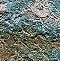 The surface of Europa, a moon of Jupiter, consists mostly of huge blocks of ice that have cracked and shifted about, suggesting that there may be an ocean of liquid water underneath. Image credit: NASA ( http://www.nasa.gov/worldbook/europa_worldbook.html)