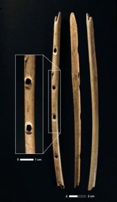 A bone flute from Hohle Fels with enlarged image of finger holes