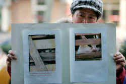 Women holding pictures of  trapped cats cry as they take part in a protest in Beijing, China, Thursday, Dec.18, 2008. (AP Photo/ Elizabeth Dalziel)
