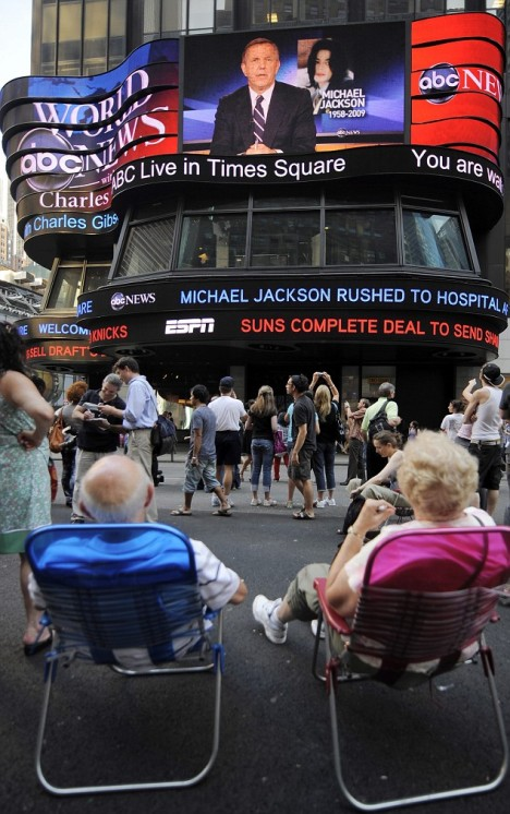 Total shock: Fans in Times Square, New York, watch the news break of Michael Jackson's fatal heart attack