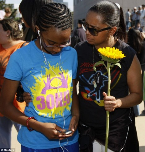 Support: A mother, Yoshika Plair (right) hugs her daughter Summer outside UCLA as they take in the news of Michael Jackson's death