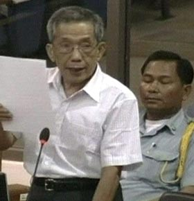 In this image photographed from TV footage, former Khmer Rouge prison commander Kaing Guek Eav, also known as Comrade Duch, reads a statement earlier this year at Cambodia's war-crimes tribunal.  (APTN/Associated Press)