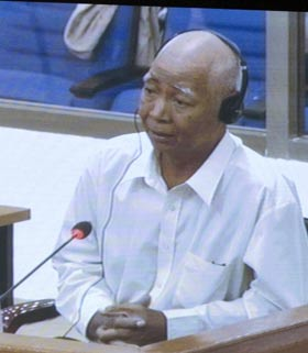 Vann Nath, a survivor from the Tuol Sleng prison during the Khmer Rouge regime, is seen on a television screen at a court press centre during his testimony at the UN-backed tribunal Monday in Phnom Penh, Cambodia.  (Heng Sinith/Associated Press)