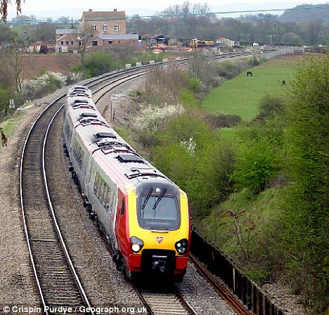 Near miss: Noah Hodgkiss survived after being hit by a train in Worcestershire while he scrabbled around for his mobile phone (Dailymail.com)