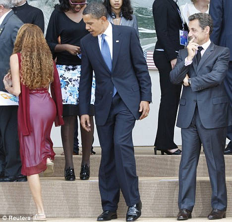 What will Michelle say? Barack Obama appears distracted by something as President Sarkozy looks on