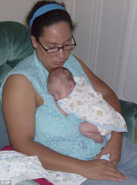 Horror: Two pictures from the family album show Otty Sanchez with her baby boy, Scott Wesley Buchholtz-Sanchez  Read more: http://www.dailymail.co.uk/news/worldnews/article-1202776/Pictured-The-mother-accused-stabbing-week-old-baby-boy-death-mutilating-corpse.html#ixzz0y4rhmpSg
